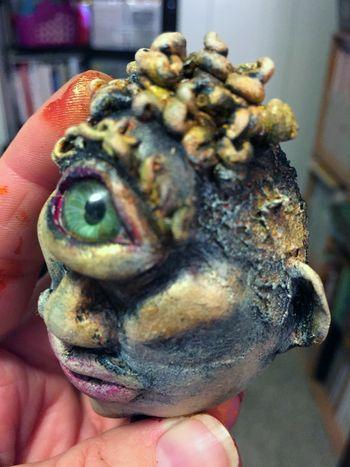 Curly Joe - Dirty Rotten Egg Sculpture - side view - Gwen Lafleur