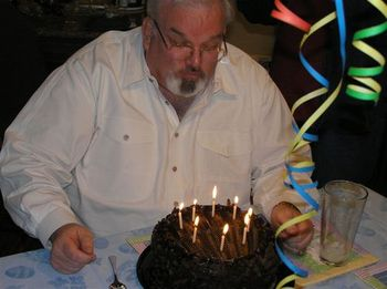 Dad_blowing_out_candles
